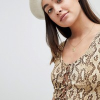 Emory Park 90's tie front top in snake print at asos.com