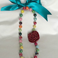 Girls, Toddlers and Babies Colored shimmer beads and red flower necklace