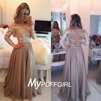 Topaz Gold Long Sleeves Sheer Back Tulle Prom Gown With Gold Appliques