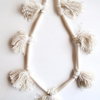 Cream tassel necklace with long beads and bone beads on gold leather cord summer trends allergy free necklace An Astrid Endeavor