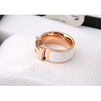 Hermes:Titanium steel plated rose gold letters black and white ring men and women couple ring / finger ring