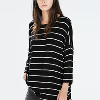 Three quarter sleeve striped t-shirt