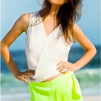 Neon yellow pleated skort
