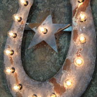 horse shoe with star lighted metal marble rust finish light fixture