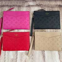 LV Louis vuitton new product solid color embossed letters ladies clutch bag cosmetic bag toiletry bag