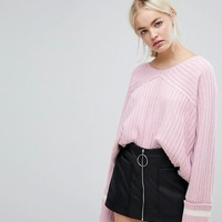 J.O.A Relaxed Varsity Jumper With Xl Sports Stripe Cuffs at asos.com