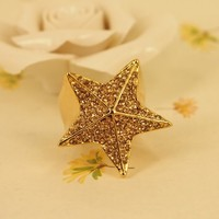 MagicPieces Rhodium Plated Alloy Oversize Star Shape Ring for Women in Golden Tone in US6 and US 7
