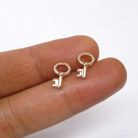 A rose gold plated mini key earrings, A minimalist earrings, A cartilage/tragus ring, Key of Love ear studs