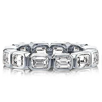 A Stunning 7.2TCW Emerald Cut Bezel Set Sapphire Eternity Ring