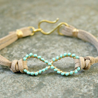 Turquoise Infinity Bracelet Wire Wrapped Gold Brass and Suede MADE TO ORDER