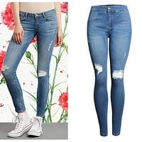 The new high-waisted women with ripped blue jeans