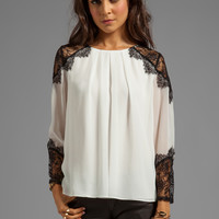 Alice + Olivia Danyelle Lace Shoulder Pleat Front Blouse in Ivory from REVOLVEclothing.com