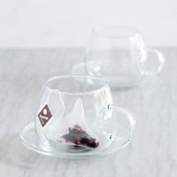 Glass cup and saucer