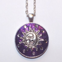 Gorgeous Purple Glitter Crystal Clay Embellished with White Swarovski Crystals and Finished with A Sun Design Metal Work