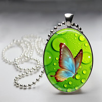 Butterfly and bubbles Oval Glass pendant Necklace. Handmade 18x25mm Oval Jewelry