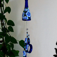 Cobalt blue wine bottle Wind Chime, Lt. Blue flowers, yard art, patio decor, recycled bottles, blue glass, Circle glass