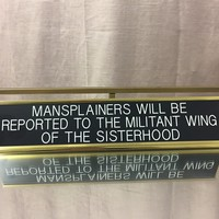 MANSPLAINERS WILL BE REPORTED TO THE MILITANT WING OF THE SISTERHOOD Nameplate Desk Accessory in Black and Gold