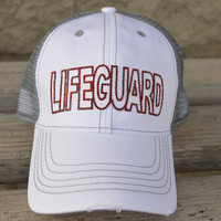 Lifeguard Hat red rhinestones on a white and light grey mesh trucker cap