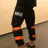 NIKE retro overalls tide brand thin section sports loose quick-drying nylon functional pants F-AG-CLWM Black