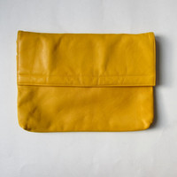 90s yellow leather purse or clutch.