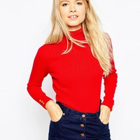 ASOS Rib Jumper With Roll Neck with Button Cuff at asos.com