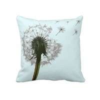 Dandelion blowing, seeds scattering pillows from Zazzle.com