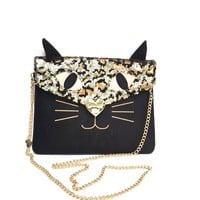Hey Kitty Cat, what's in your bag? Stash your essentials in this purrrfectly cute crossbody bag for a look that's the cat's meow. Man-made material. Envelope flap with magnetic heart lock snap. Black & gold sequin leopard pattern cat motif on front with bl