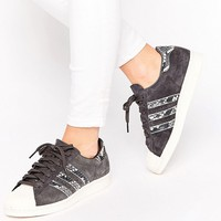 adidas Originals Black Superstar Sneakers With Faux Snake Detail at asos.com
