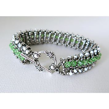 Enchanted - Peridot Crystal - Glass Seed Bead Woven Tennis Bracelet - Gunmetal , White Alabaster - Toggle - August Jewelry