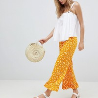 ASOS DESIGN Trousers With Fluted Ruffle Hem In Spot Print at asos.com