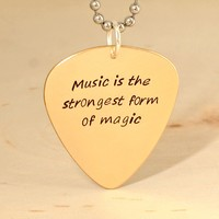 Music is the strongest form of magic bronze guitar pick necklace
