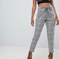 PrettyLittleThing paper bag waist trousers in grey check at asos.com