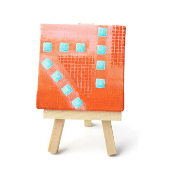 Mini abstract painting on canvas in coral and turquoise, geometric pattern of squares comes with easel