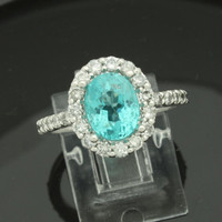 14 karat white gold mounting is set with a bright oval 1.92 Paraiba Apatite gemstone and complimented with 0.84 carats in fine diamonds!