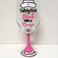 Nurse hand-painted wine glass Safety First Drink with a Nurse