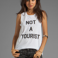 Local Celebrity Not A Tourist Muscle Tee in White from REVOLVEclothing.com