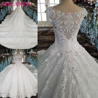 2017 High Quality New Fashion Lace Appliques Ball Gown Off White Ivory Tulle Wedding Dresses Cap Sleeves Bridal Gown Custom Size