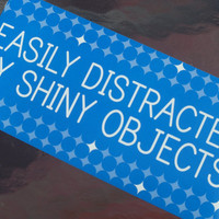 Easily distracted by shiny objects ...blue and white with diamonds humorous bumper sticker humorous gag gift