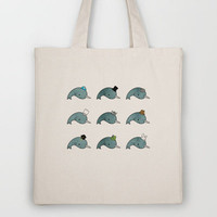 The many hats of Narwhals Tote Bag by Hello Happy