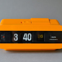 Vintage flip clock alarm clock West German Krups tangerine orange space age atomic Mid-Century 60s 70s
