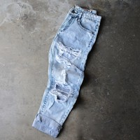 light acid wash destroyed boyfriend jeans