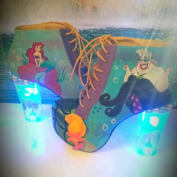 Mermaid and sea witch. Ariel and ursula boots light up. Dingle hopper. Disney bounding