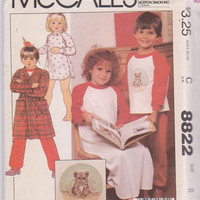 Vintage 1980s pattern for child long sleeved knit pajamas or nightgown with iron-on transfer and wrap front robe size 8 McCall's 8822 UNCUT
