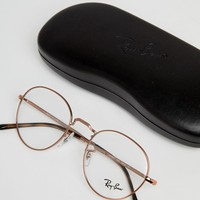 Ray-Ban 0RX3582V Round Clear Lens Glasses In Gold 49mm at asos.com