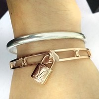 LV Louis Vuitton New Fashion Classic Lock Hollow Stainless Steel Jewelry Accessories Bracelet Women