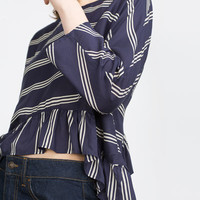 BLOUSE WITH FRILLED HEM