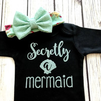 {Secretly A Mermaid}