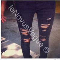 Black ripped jeans .