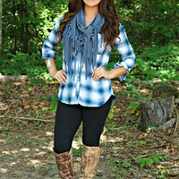 Our Fishin' In The Dark Plaid Top in Blue is perfect for the Southern Fried Chic in you! This plaid button up top features 3/4 length roll sleeves, a front pocket, & is super soft! Pair this top with jeans or leggins to create a perfect outfit.