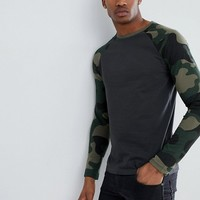 ASOS DESIGN long sleeve t-shirt with camo sleeves at asos.com